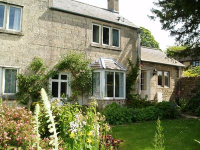 Photo for Beautiful garden cottage in Painswick, Queen of the Cotswolds