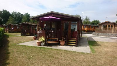 Photo for Mourholme, 2 Arnside, a lovely refurbished lodge with lake view on 5 star park