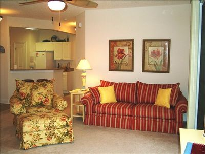 Bright and Cherry Great Room with Sleeper Sofa and Cozy Lounge Chair