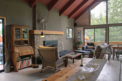 Main living area with gas fireplace, game table, dining table and media area