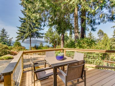 Photo for NEW LISTING! Quaint cottage w/furnished deck, gorgeous bay view & gas fireplace