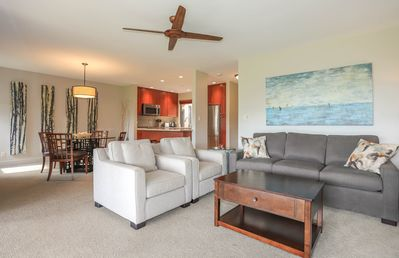 Modern living room, dining room and kitchen with all the amenities!