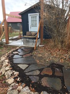 pathway from cottage to gate off alley for easy walking access to trails