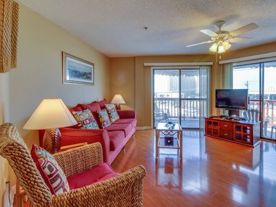 Photo for Relaxing retreat steps to the beach w/ shared pool & sauna! Snowbirds welcome!