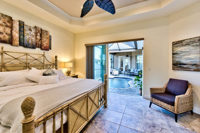 Master Bedroom with Private Entrance to Pool Area. King Size Bed and Fan; Flat Screen TV!