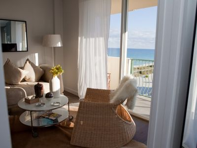 living room with ocean view from 9th floor designer decorated unit.