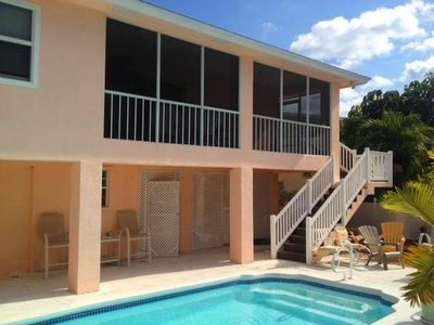 Photo for Canal Cottage, Marathon FL Keys canal front with pool, pool table, dock, and space for 8 guests