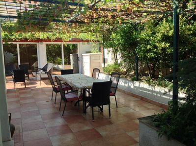 Huge outdoor terrace with grape canopy cover and 2nd seating area with view