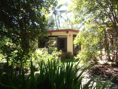 The Honey House is a bungalow in a tropical garden