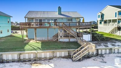 Rear View of Deck, Seawall, and Stairs to Beach