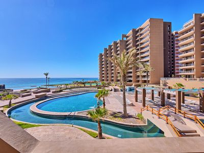 Photo for Las Palomas Ground Floor Beach Condo - HUGE Patio, Steps From The Pools!