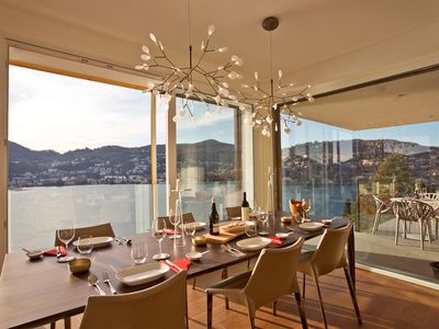 Photo for Executive penthouse with 180 degree panoramic lake, mountain and city views.