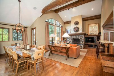 Open floor-plan on the main floor with dining area, living area, kitchen & bar
