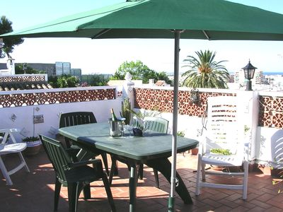 Photo for Wonderful roof terrace with views over old town to sea.
