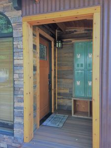 Covered front entry with lockers and rack to hang skis