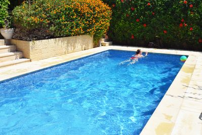 Pool surrounded by mature garden providing privacy and seclusion