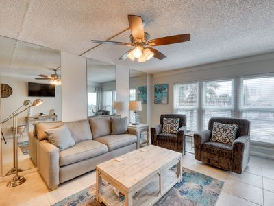Photo for Bright, waterfront condo w/ a shared pool, tennis courts, & grilling area