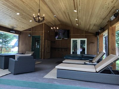 Even in inclement weather, enjoy the outdoors on the covered deck with hot tub!