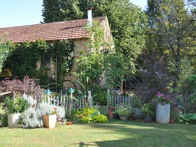 Photo for Gite 4 pers. Dordogne surrounded by trees and close to a traditional inn