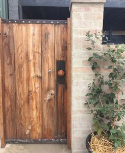 A beautiful walled garden awaits beyond the hand- crafted gate