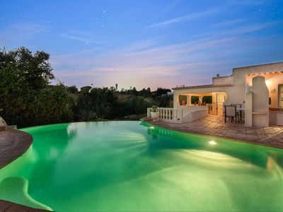 Photo for Beautiful 3 bedroom villa with heated pool, walking distance of town and beach