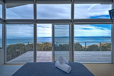 Listen to the waves from bed and wake up to this stunning view