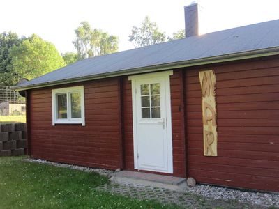 """Photo for 3-room log cabin """"Mar"""" with fireplace (49m², 4 pers.) - Landhaus San-Mar with apartment and log cabins near Kühlungsborn"""