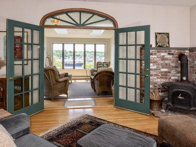 Photo for WaterViews Overlooking Gloucester Inner Harbor /Sunroom/ Deck /Walk to Town/ AC