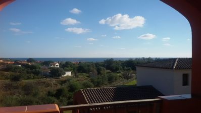 Photo for Central Apartment Close to the Beach with Balcony, Sea View & Air Conditioning; Parking Available, Pets Allowed