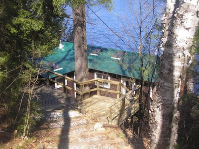 Photo for Waterside Cabin, in scenic White Mountains with deck perched over water's edge.