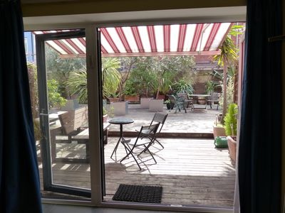 Photo for Quiet central 5- Star, duplex garden apartment close to river - ideal for 4
