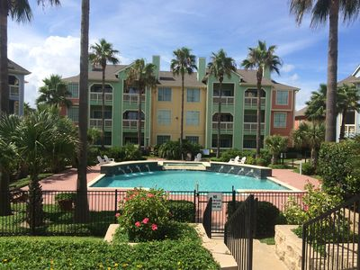 Spacious 2br/2bath condo poolside...1st floor.....beach across the street