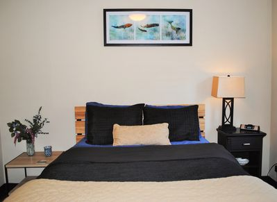 Both bedrooms have low profile modern queen beds with down duvets