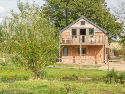 Photo for A beautifully renovated barn overlooking striking grounds and farmland