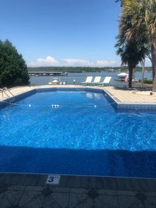 large pool with lake view, in pool volleyball net