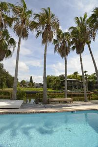 Photo for Waterfront Pool Home 5 min from beach, kayaks, bikes, pool table!
