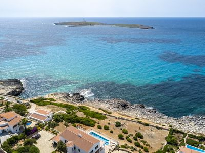 Photo for Beautiful villa right on the sea front, Punta Prima