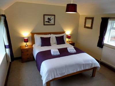 The double room with king-size bed has glorious dual aspect countryside views.