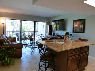 Spacious center island with granite counter tops.