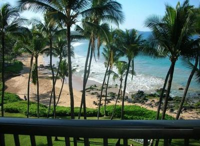 Wake up to the beautiful blue ocean, beach, and view with the lawn below.