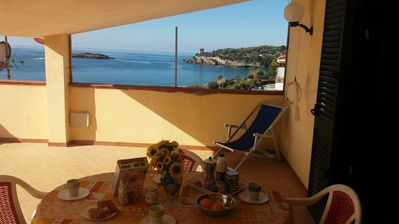 Photo for Panoramic penthouse with 2 bedrooms and veranda overlooking the sea 150 meters from the beach