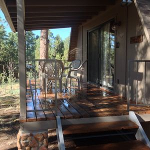 Spacious front porch with a great view of ponderosa trees.