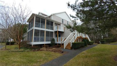 Photo for Great upstairs corner unit with wrap around screened porch. 56111