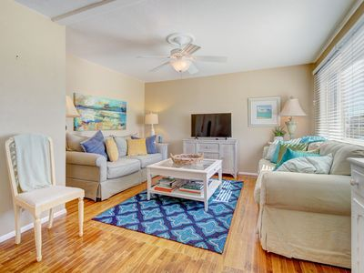 Photo for Bright, remodeled home w/ patio & grill - close to town, parks & the beach!