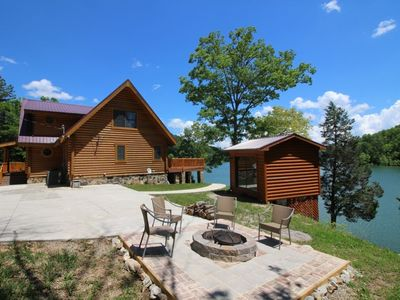 Photo for Breathtaking lake views from custom log cabin with private dock