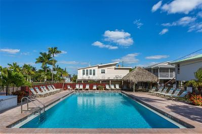 Welcome to Cane Palm 202 - Heated pool, palm trees, and a velvety beach and the Gulf of Mexico mere steps away: When you stay at Cane Palm 202, you can relish the best that Florida has to offer.