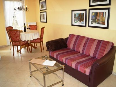Photo for Tastefully and high quality equipped apartment with a covered terrace - close to the beach and the center; Wi-Fi use free of charge