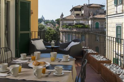 The terrace with wonderful view on Saint Peter and Trastevere roofs
