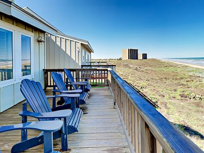 Deck - Breathe the fresh coastal air from your 2nd-story deck equipped with 4 Adirondack chairs.