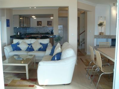 Large lounge with comfortable leather settees